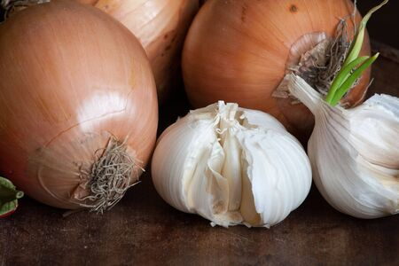 garlic and onions on dark wooden background Stock Photo
