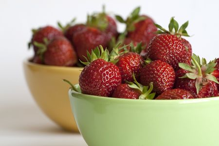 Fresh and tasty strawberries in two bowls Stock Photo