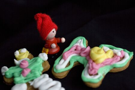 Closeup of homemade christmas gingerbreads with colorful sugarcoating
