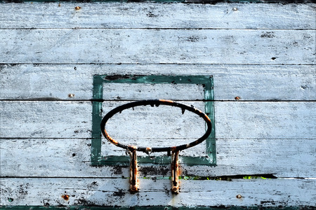Close up old basketball hoop with blue sky background. Stock Photo