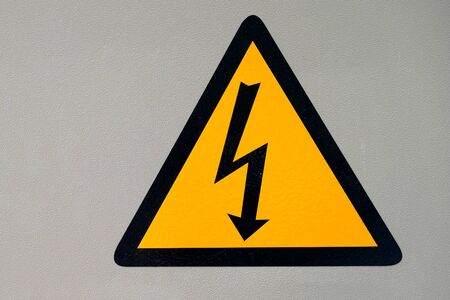 High voltage symbol on wiring cabinet Imagens