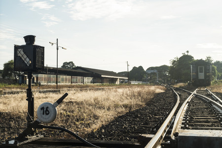 Railroad switch with train in the morning.