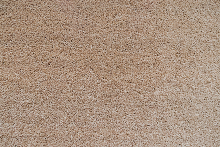 Seamless neutral brown carpet texture background.