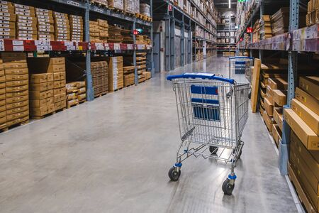 Samut Prakan, Thailand - September 26,2019 : 2 cart in warehouse aisle in an IKEA store. IKEA is the world's largest furniture retailer.