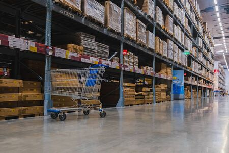 Samut Prakan, Thailand - September 26, 2019 : A cart in warehouse aisle in an IKEA store. IKEA is the world's largest furniture retailer.