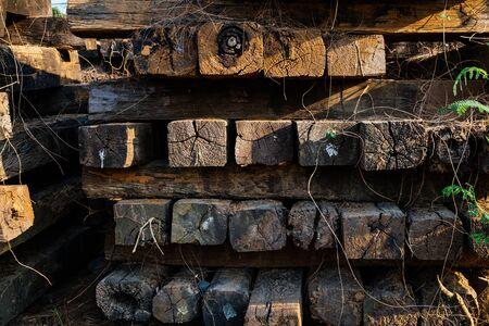 Pile of old wooden railway sleepers.