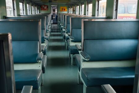 Seat on the old train with evening sun.