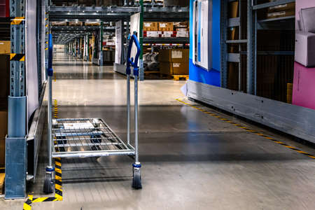 Samut Prakan ,Thailand - January 26,2020  : A cart in warehouse aisle in an IKEA store. IKEA is the world's largest furniture retailer.