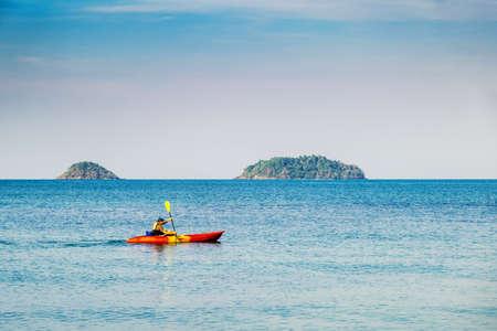 Ko Chang,Thailand - January 15, 2020:A man kayaking in the sea Ko Chang,island background. Redakční