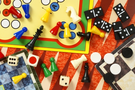 Top view of board games, pawns, chessmen, dominoes and dices Stock Photo