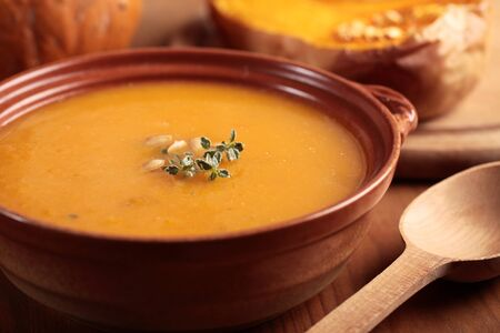 pumpkin soup: Bowl with pumpkin soup and and baked butternut squash