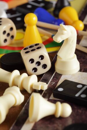 Detail of board games, pawns, chessmen, dominoes and dices.