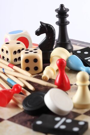 board game: Detail of board games, pawns, chessmen, mikado and dices