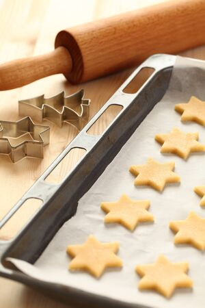Baking cookies for Christmas. Cookies on baking sheet. Stock Photo