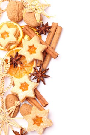 Dry orange slices, spices and Christmas cookies on white background. Stock Photo
