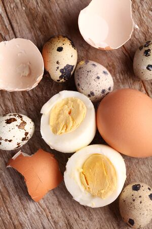 hard boiled: Close-up of hard boiled egg, egg shells and quail eggs.