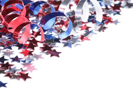 Red, white and blue stars and ribbons on white background with copy space photo