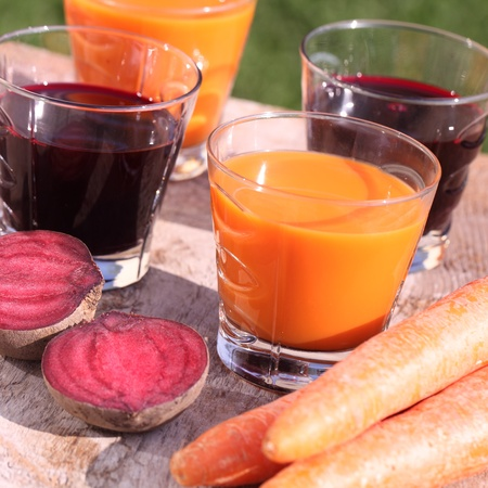 Carrot and beetroot juice and fresh vegetables photo
