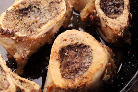 Close-up of roasted marrow bones in a pan