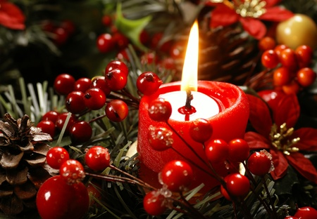 Red candle and christmas decorations photo