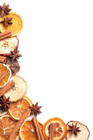 Border of dry fruits - orange, lime, apple and spices white copy space