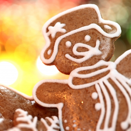 Close-up of Christmas gingerbread cookie with blurred lights background photo
