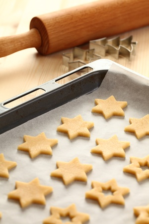 cookie cutter: Baking cookies for Christmas. Cookies on baking sheet. Stock Photo