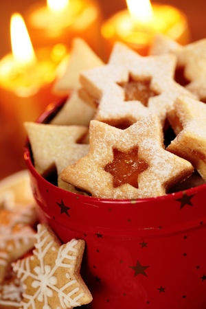 Christmas cookies in red tin and candles Stock Photo