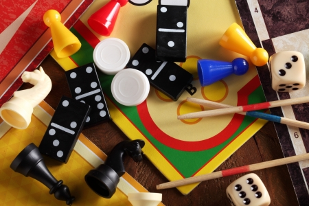 board games: Top view of board games, pawns, chessmen, dominoes, mikado sticks and dices