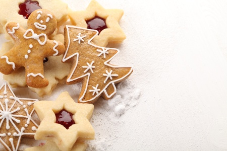 shortbread: Close-up of shortbread cookies and gingerbread on white wooden background.