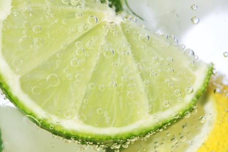 Close-up of lime in drink. photo