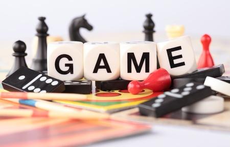 Detail of board games, pawns, chessmen, dominoes, mikado sticks