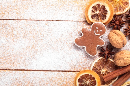 Gingerbread cookie and spices on sugar background. Stock Photo - 20868754