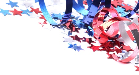 fourth of july: Red, white and blue stars and ribbons on white background with copy space. Stock Photo