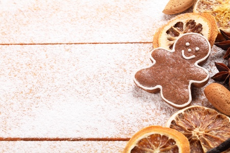 Gingerbread cookie and spices on sugar background photo