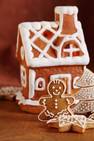 Gingerbread cookies and decorations  Focus on gingerbread man  photo