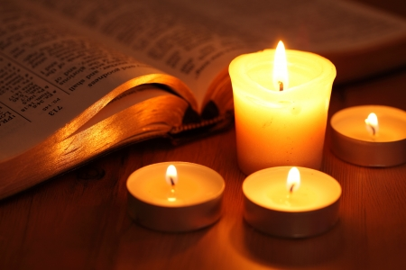 horizontal: Close-up of candles and open Bible  Stock Photo