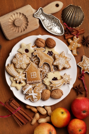 Top view of table with cookies, apples spices and vintage cookie cutters photo