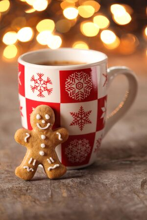 gingerbread cookie: Mug with hot drink and gingerbread cookie.