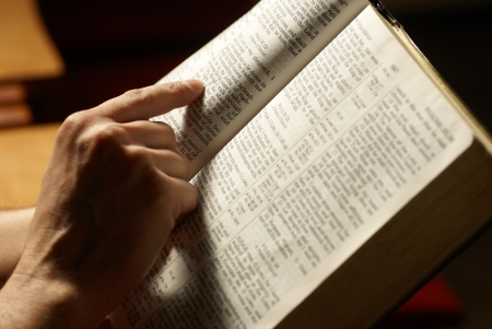 pew: Man reading Holy Bible in the church. Stock Photo