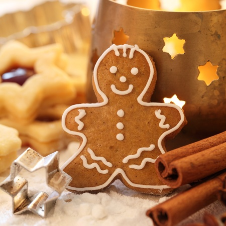 Gingerbread man, shortbread cookies, spices and candle. Stock Photo - 20901797