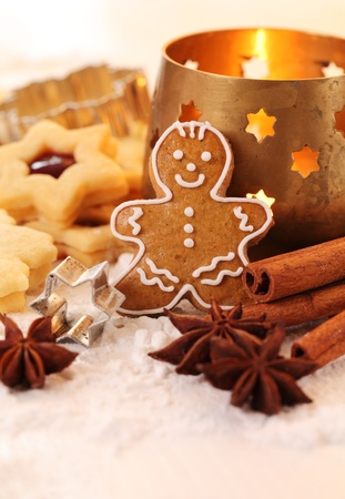 Gingerbread man, shortbread cookies, spices and candle. Stock Photo - 20901798