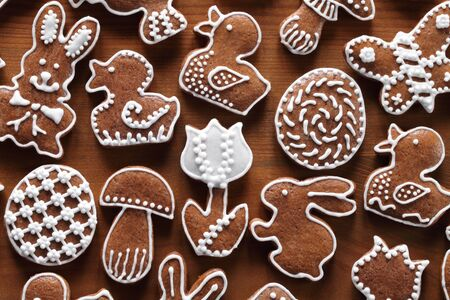 Easter gingerbread cookies on wooden background. photo