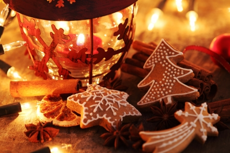 Gingerbread cookies, spices and Christmas lights. Stock Photo