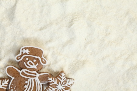 Christmas gingerbread on flour background with copy space photo