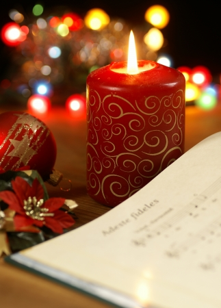 Detail of songbook with christmas carols and christmas decorations