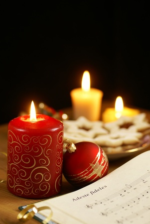 Detail of songbook with christmas carols and christmas decorations photo