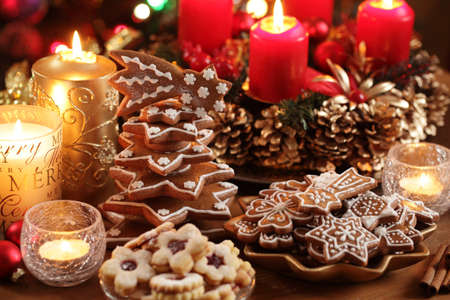Christmas cookies and decorations on a table.  photo