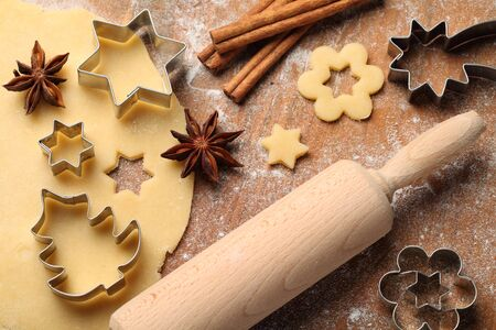 Pastry for Christmas cookies, spices and cookie cutters. photo