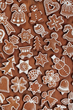 Various gingerbread cookies on wooden background. photo